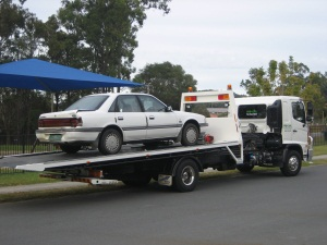 Ford Telstar Ghia on the tow truck after being written off in motorway accident