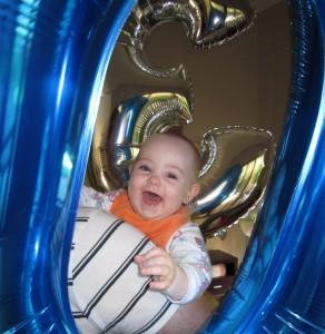 Evie looking through a mega-balloon