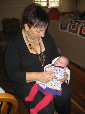 Evie being nursed by Judy Lattimore