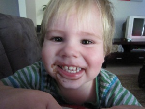 Hugo with chocolate ice cream on his face