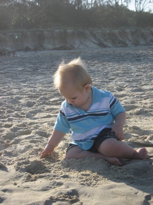 Hugo Lattimore enjoying playing in the soft sand at Kingscliff beach