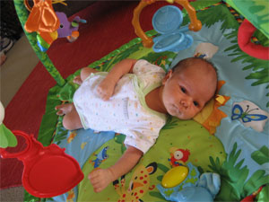 Hugo Lattimore at age 1 month enjoying time on the playmat