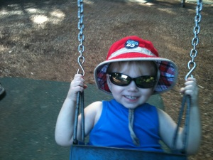 Hugo Swinging With Red Bucket Hat, Sunglasses & A Big Smile