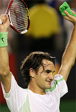 Roger Federer celebrating after claiming the 2006 Australian Open title